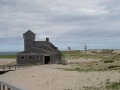 Old Harbor Life Saving Station - Built on North Beach in Chatham in 1897, Abandoned by the Coast Guard in 1947 and sold into private ownership. Purchased by the National Park Service in 1973.  After decades of coastal erosion on the eastern shore of North Beach, the station was perilously close to the ocean.  In October 1977 the station was lifted onto a barge and towed to Provincetown. It  was placed in its current location at Race Point in May 1978.  Today it is a Life Saving Service…