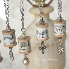 Turn an old lamp into a jewelry display for repurposed thread spool necklaces.
