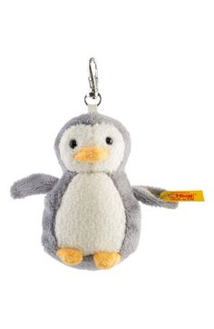 Free shipping and returns on Steiff Penguin Stuffed Animal Bag Charm at Nordstrom.com. Internationally renowned for exceptional quality, traditional materials and proven manufacturing techniques, Steiff has been making plush toys and collectibles that have set a standard for heirloom-quality products since 1880. This hand-sewn and hand-finished penguin features cuddly faux fur and a friendly face that's sure to delight, with an attached clip that's perfect for your purse, backpack or keys…