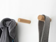 """Have to much stuff piled on the floor? Use these """"Molo Cork Pegs"""" to hang up those items. Magnetic system on the base of the peg create a clean look that can hold up to lbs. Peg Wall, Wall Hooks, Cork Flooring, Wall Design, Objects, Base, Writing, Create, Wall Mounted Hooks"""