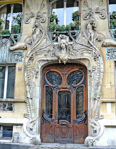 A beautifully detailed Art Nouveau door. It just oozes beauty, from the scrolling leaves to the busts.