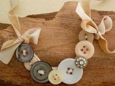 """This step-by-step tutorial will show you how to make a designer button necklace from Celebrity Jewelry designer Michele Baratta.    This is such an awesome DIY, if I do say so myself!  How to make a button necklace that is a """"shabby chic"""" style. I cannot tell you how many people have come up to me and asked about my necklace.  I'm so excited too ..."""