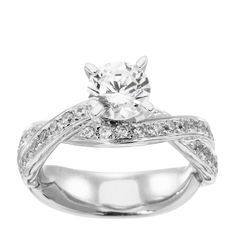 Rialto - Looking for a classic engagement ring with a twist?  The Rialto multi-stone engagement ring is the one! Its twisting band is filled with a generous cascade of round diamond simulant accents for an intricate, trendsetting look, all at an affordable price!   Center stone available in a range of diamond simulant sizes. See menu above. 65 prong-set Round Brilliant cut accents Order additional services like a personal engraving or an appraisal   for $25 each. Contact …