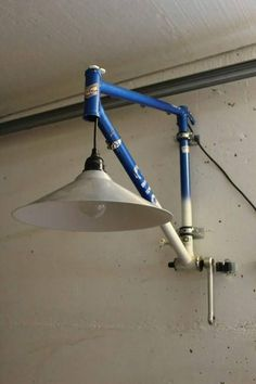 Upcycling unique from recycled material. Bicycle parts lamp. Lamp with reuse . Upcycling unique from recycled material. Bicycle parts lamp. Lamp with reused bike frame Source by veganisstgruen