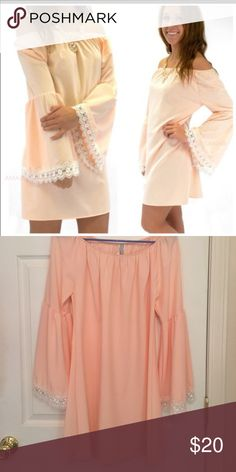 Off the Shoulder Dress Off the shoulder, bell sleeve shift dress with lace detail. Peach/coral in color. Semi-sheer 96% polyester. New without tags, never worn. Shop Hope's Boutique Dresses Mini