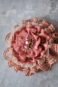 Idea for handmade flower - layer rosettes of lace, tulle, ribbon or fabric with pretty button for centre. Fabric Flower Brooch, Fabric Flower Tutorial, Fabric Roses, Fabric Ribbon, Bow Tutorial, Cloth Flowers, Lace Flowers, Wedding Flowers, Textile Jewelry
