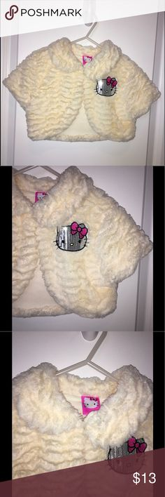 👛Hello Kitty Toddler Girl Cardigan👛 Beautiful fluffy, soft and elegant cardigan. Color: light cream. It goes with everything.  It comes from a pet and smoke free home. No stains or rips. Brand: Hello Kitty. Hello Kitty Jackets & Coats Vests