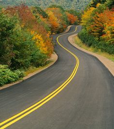 Highway in fall colours, Cape Breton Highlands, Nova Scotia, Canada