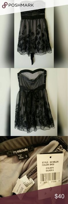 """NWT My Michelle Glitter Rose Black Formal Dress My Michelle grey dress with black tulle/chiffon overlay covered in sparkle glitter gothic roses. Satin silk tie around waist and ruched bodice with sweetheart neckline with padded bust. Strapless. Perfect dress for cocktail, homecoming, prom, wedding, NYE, New Years, Military Ball, birthday or any other formal event! Gorgeous and flattering. Size 9 in juniors. From armpit to armpit measures 16"""", waist 13"""", skirt 18"""", total dress length 27"""". My…"""