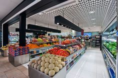 "Modern Retail Food Market. This Italian imported food emporium provides a modern approach to gourmet food shopping. Clean architectural lines and sophisticated materials guide the design approach, as does the concept of ""Food as Fashion."""
