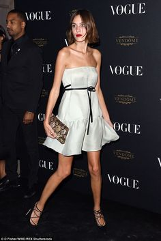 Feminine: Alexa Chung looked very ladylike indeed in a lightly-coloured, strapless mini-dr...