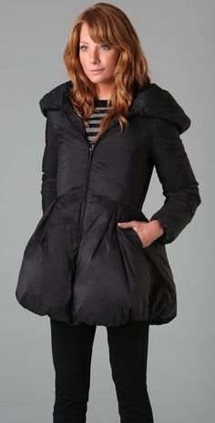 """Minimize/Magnify: We would """"magnify"""" (extend) the length of the jacket to right below one's bottom."""