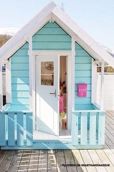 Pretty little play shed - in Need Of Shed Color Ideas?! British bunting on a garden shed. A beautiful shabby chic garden shed.