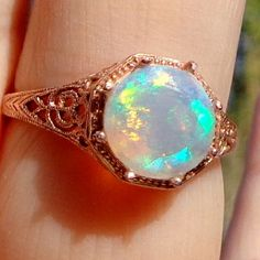Solid 10k Rose Gold Welo Opal Ring by JanesGemCreations on Etsy, $269.00.  (That's a TEN!  10mm.  Oh!)
