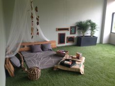 Sweet cozy nook... Love the earth tones and hanging leaves