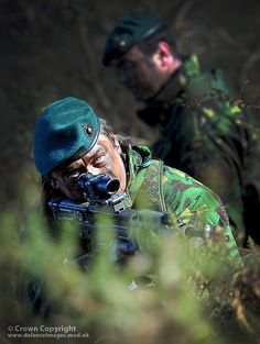 Royal Marines on Exercise. Royal Marines are pictured on exercise in UK woodland.