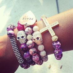 Purple, pink, black and gold Armcandy