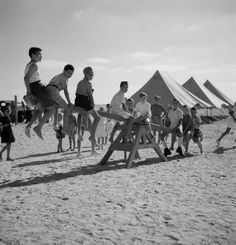 At the El Shatt camp near the southern end of the Suez Canal, thousands of Yugoslavian refugees were settled in tents pitched in the baking sands.
