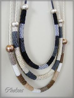 Chelseaspearls: Two-Drop peyote, zip close, thread cable or cording through, add an end bead at each end.