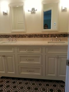 Omega Cabinetry vanity, Crema Marfil countertop,  Hexagon floor and border CK Kitchen & Bath Design, Inc.