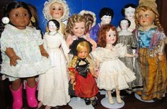 AG Kaya;  Antique china heads;  a couple celluloid;  Hard plastic Nancy Ann;  bisque Shirley Temple;  and in back Felicity, and 2 antique bisque & composition dolls.
