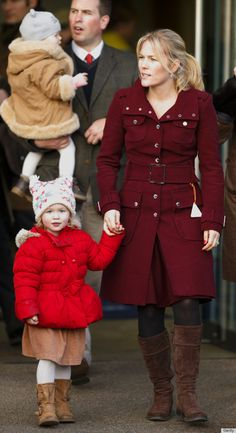 Peter Phillips carries daughter Isla Philips, his wife Autumn Phillips and daughter Savannah Phillips attend the 2013 Christmas Meeting at Ascot Racecourse in Ascot, England.