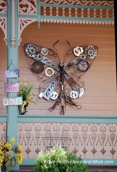 Quirky, yet beautiful salvaged art butterfly sculpture for your porch wall.