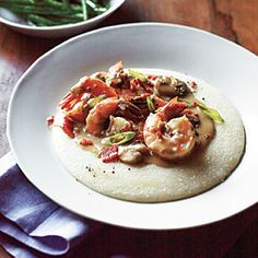 Shrimp and Grits | MyRecipes.com - Shrimp and Grits, a low-country favorite, makes a hearty, one-dish dinner and is table-ready in 30 minutes. Sustainable Choice: Buy Pacific white shrimp farmed in recirculating systems or inland ponds.