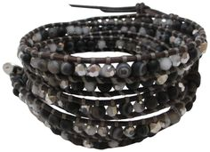 """Chan Luu Black Crystal Mix Wrap On Natural Brown Leather Bracelet. Chan Luu wrap bracelet , a natural dark brown leather strand frames an assortment of beads that include black sardonyx semi-precious stones, silver night crystals and gunmetal plated nuggets. sterling silver Chan Luu engraved curved oval button with 3 adjustable closures that measures approximately 32"""" / 33"""" / 34"""" in length. wraps around the wrist approx: 5x's , 4mm beads. image may be enlarged to show detail - please…"""