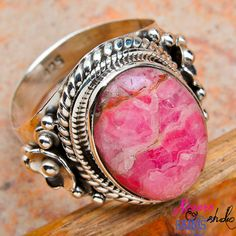 'Sin City Sterling Rhodochrosite Ring SZ 9 1/2' is going up for auction at  2pm Tue, Feb 26 with a starting bid of $10.