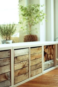 ikea hack: expedit shelving used as bench with reclaimed wood storage bins. Could find wood crates for a similar look