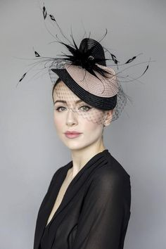 Our Rose Splash hat is made from sisal straw braid and designer coque feathers. A wonderfully flattering design which does many things; the angle is flattering on all face shapes and the veiling adds a softness around the eyes. The hat sits off the face giving a sense of space and movement. The hat is finished with a