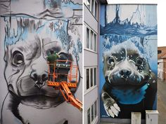 Belgium-based street artist Bart Smeets (a.k.a. Smates) has created a beautiful and realistic mural depicting a larger-than-life diving dog that looks like it's having the time of its life.