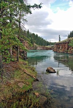 The Yukon River calms in an eddy at Miles Canyon, Whitehorse, Yukon Yukon Canada, O Canada, Yukon River, Pictures Of Beautiful Places, Yukon Territory, Pastel Paintings, Laundry Hacks, Largest Countries, Layout Inspiration