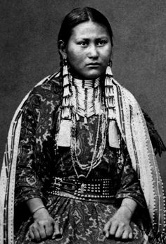"""Dakota Lakota (commonly called """"Sioux, but that's considered to be derogatory) woman, Tall Prairie Chicken. Photographed between 1880-1900."""