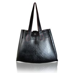 Rocklane Rocklane Bag is made out of recycled tire tube material, to protect wild life and environment. This highly detailed hand made is ecofriendly and makes a fashionable statement for you!