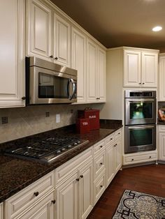 Image result for black countertops with brown flecks and white cabinets