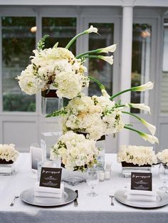 Elevated flowers. 7 Unexpected Reception Centerpieces   TheKnot.com