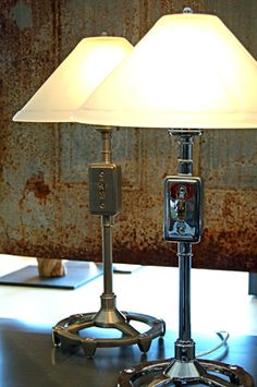 Switch Table Lamp    These table lamps are offered in both a polished chrome and brushed steel finish. They are topped off with a beautifully crafted heavy frosted glass shade. These switch lamps provide ample ambient light with an industrial flare.