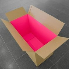 "Bright pink shipping box interior. Can you imagine the ""wow"" when this package is opened?"
