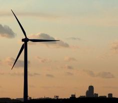 TWISTS AND TURNS: A wind turbine, similar to the 130 such devices Cape Wind Associates plans to construct on Nantucket Sound, generates power in Hull in the shadow of Boston. Some are now questioning the safety of the Cape Wind project.