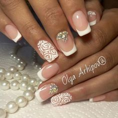 The Round and Round White Florals. Create your own fusion look of your nails using the swirling flow of brush. Add your creativity and you are done with this amazing nail art design.