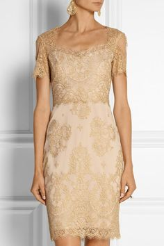Notte by Marchesa ..The picture of modern romance, Notte by Marchesa's dress is beautifully cut from delicate metallic lace. The sheer yoke, scalloped edges and fitted silhouette give the design a supremely feminine look. Wear it for evening with nude sandals and a box clutch. Beige and gold lace Concealed hook-fastening keyhole and zip fastening at back 62% nylon, 27% rayon, 11% polyester; combo: 100% rayon; lining: 100% polyester Dry clean