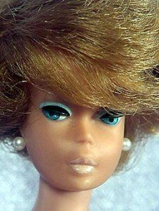Side-part Bubblecut Barbie with American Girl Face. (Some transitional side-part Bubblecut Barbie Dolls have the American Girl head and markings.)