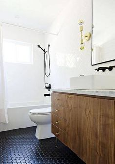 best faucets white bathroom with black tile floor
