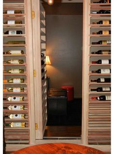 Wine storage with a Secret door.hmmm seems backwards wine cellar should behind the secret door for a nice relaxing escape. Secret Storage, Wine Storage, Hidden Storage, Secret Walls, Secret Rooms, Hidden Spaces, Hidden Rooms, Passage Secret, Panic Rooms