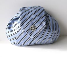 ummmmm, this little clutch is made from a man's tie. How cute is that?!