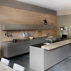 A Kitchen Design with grey Bulthaup units sawn oak wooden panelling and wine fridge. Kitchen design ideas for units, tiles, taps, modern city Kitchens Kitchen Furniture, Kitchen Interior, Kitchen Decor, Cheap Furniture, Furniture Buyers, Furniture Nyc, Furniture Stores, Kitchen Ideas, Outdoor Furniture