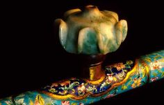 Metal Opium Pipe featuring 'Canton Enamel' and a yellow and green Jade Bowl. The technique of painting enamel on metal was developed in Limoges, France and brought to China by French missionaries in the 18th C. close--up view