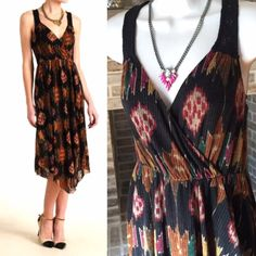 Free People wrap assymetrical printed dress Get all wrapped up in this Southwest native inspired print; autumn shades based on black, this sleeveless maxi dress with asymmetrical hemline features a pleated lightweight polyester fabric with a V-neck front and a racer back with smocking. Dress it up or dress it down with accessories; it's three-quarters lined. Will look awesome with boots and denim jacket. Perfect for fall! New without tags, in excellent new condition. Free People Dresses